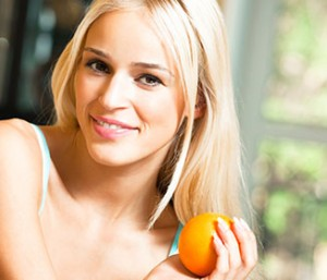 Young smiling woman with orange